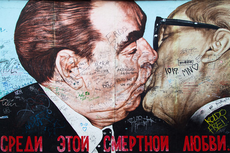 mauer: BERLIN, GERMANY - AUGUST 8: Graffiti Brotherhood Kiss by Dmitri Vrubel on the East Side Gallery, the longest preserved section of the Berlin wall, on August 8, 2015  in Berlin, Germany. Editorial