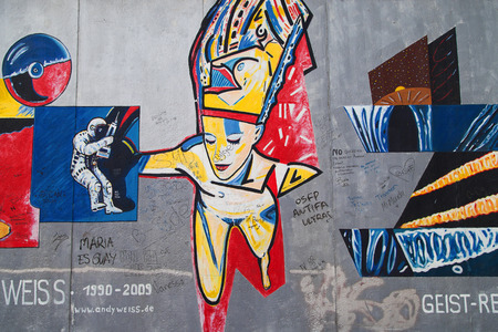 weiss: BERLIN, GERMANY - AUGUST 8: Mural Geist Reise by Andy Weiss on the East Side Gallery, the longest preserved stretch of the wall, on August 8, 2015 in Berlin, Germany.