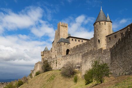 walled: CARCASSONNE, FRANCE - APRIL 4: Ramparts and towers of the citadel of Carcassonne, Languedoc-Roussillon, France.