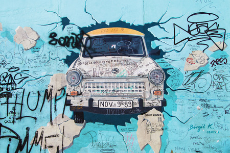 kinder: BERLIN, GERMANY - AUGUST 8: Mural Test the Rest by Birgit Kinder on the East Side Gallery, the longest preserved stretch of the wall, on August 8, 2015 in Berlin, Germany.