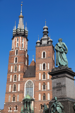 stare miasto: St Mary Church and Adam Mickiewicz Monument in Krakow, Poland.