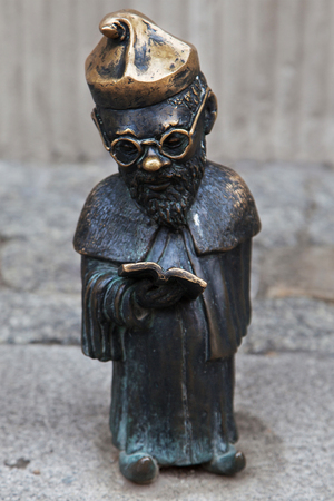 dwarves: Wroclaw, Poland - August 10, 2015: Professor dwarf in Wroclaw, Poland. Considered a tourist attraction, there are over 300 figurines of dwarves spread all over the city since 2001.