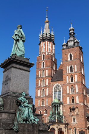 mickiewicz: Adam Mickiewicz statue and Saint Mary Basilica in Krakow, Poland. Stock Photo