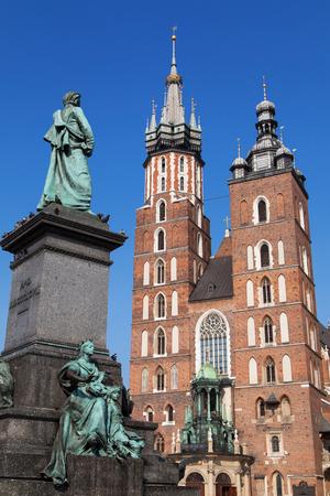 stare miasto: Adam Mickiewicz statue and Saint Mary Basilica in Krakow, Poland. Stock Photo