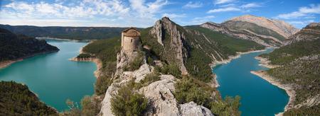 hermitage: Hermitage of La Pertusa over the Canelles reservoir in La Noguera, Lleida, Catalonia.
