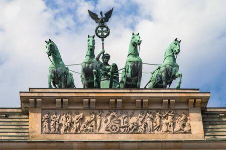 quadriga: Quadriga atop the Brandenburg Gate in Berlin, Germany.