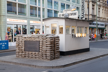east berlin: Berlin, Germany - August 7, 2015: Checkpoint Charlie in Berlin, Germany. It was the former border crossing between the West and East Berlin during the Cold War.