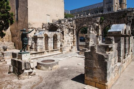 vestige: Ruins ot the Augustus Gate in Nimes, France. Stock Photo