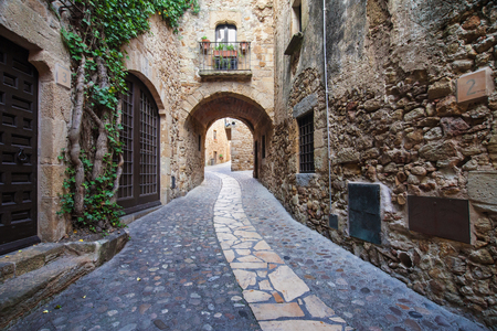 town: Passageway in the old town of Pals in Girona, Catalonia.