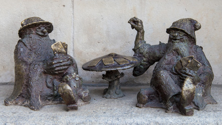 croupier: Wroclaw, Poland - August 11, 2015: Croupier dwarves in Wroclaw, Poland. Considered a tourist attraction, there are over 300 figurines of dwarves spread all over the city since 2001. Editorial