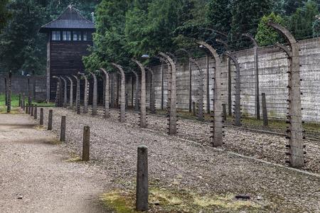 oswiecim: Watchtower and electric fence at Auschwitz I, Oswiecim, Poland.