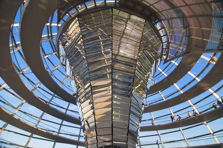 spiraling: Berlin, Germany - August 5, 2015: Interior of the Reichstag Dome in Berlin, Germany. Built to symbolize the reunification of Germany, it was designed by Norman Foster in 1995.