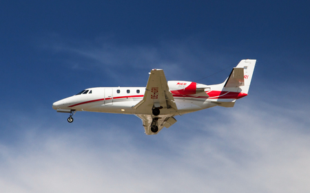 may fly: Barcelona, Spain - May 14, 2016: A Fly Tyrol Cessna 560XL Citation Excel approaching to El Prat Airport in Barcelona, Spain. Editorial
