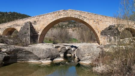 mediaeval: Old Bridge of Cabaces, Tarragona, Catalonia, Spain. Stock Photo