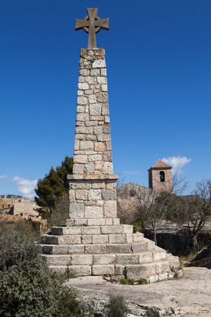 memorial cross: Memorial Cross and Church of Santa Maria in Siurana, Tarragona, Catalonia, Spain.