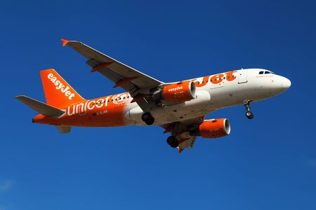 unicef: Barcelona, Spain - July 16, 2016: An Easyjet Airbus A319-100 wearing Unicef special livery approaching to El Prat Airport in Barcelona, Spain.