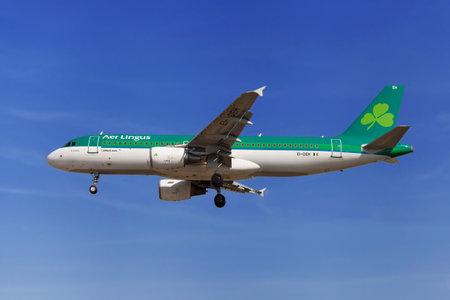 Barcelona, Spain - August 19, 2016: Aer Lingus Airbus A320-200 approaching to El Prat Airport in Barcelona, Spain.