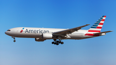 american airlines: Barcelona, Spain - August 22, 2016: American Airlines Boeing 777-200ER approaching to El Prat Airport in Barcelona, Spain. Editorial