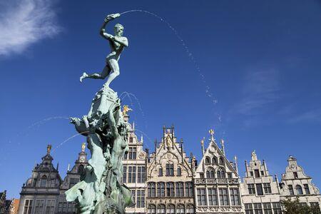 Brabo fountain and guildhalls in Antwerp, Belgium.