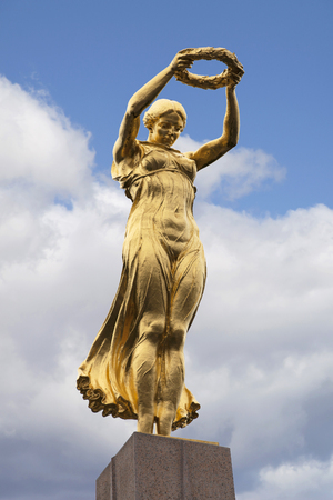 Luxembourg City, Luxembourg - October 14, 2016: The Golden Lady, sculpture of the Monument of Remembrance in Luxembourg City.