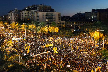 Barcelona, Spain - November 11, 2017: Catalonia independence supporters marching on a demonstration against the spanish central government on November 11, 2017 at night in Barcelona, Spain.