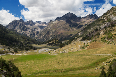 Peaks of Posets and Mall Pintrat from Llanos del Hospital, Pyrenees, Spain. Stock Photo