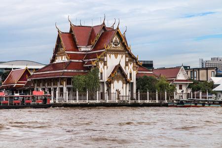 Wat Rakhang seen from Chao Phraya River, Bangkok, Thailand.