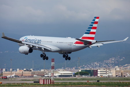 Barcelona, Spain - September 16, 2018: American Airlines Airbus A330-200 landing at El Prat Airport in Barcelona, Spain.