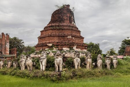 Chedi surrounded by lions at Wat Thammikarat, Ayutthaya, Thailand.