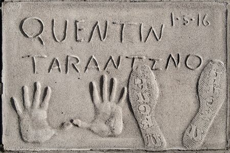 Los Angeles, California - September 06, 2019: Hand and footprints of filmmaker Quentin Tarantino in the Graumans Chinese Theatre forecourt, Hollywood, Los Angeles, California, USA. 新闻类图片