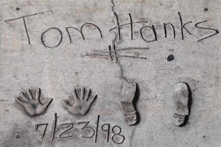 Los Angeles, California - September 07, 2019: Hand and footprints of actor Tom Hanks in the Grauman's Chinese Theatre forecourt, Hollywood, Los Angeles, California, USA. Éditoriale