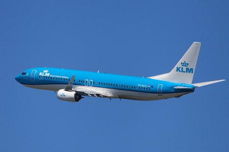 Barcelona, Spain - June 02, 2019: KLM Boeing 737-800 banking left after taking off from El Prat Airport in Barcelona, Spain.