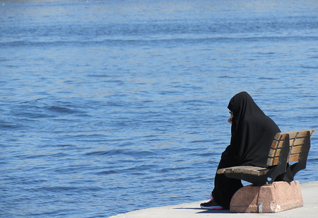 thinking woman: Hijab woman thinking on the river. Stock Photo