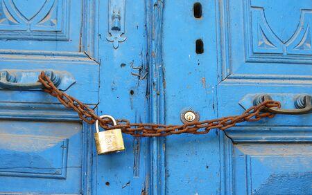 locked: old wooden door locked Stock Photo