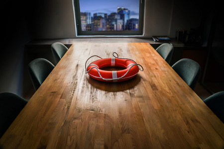 Empty meeting room, different minds and lifebuoy concept