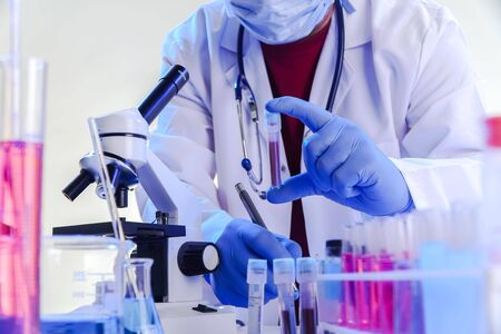 coronavirus epidemic and infectious diseases conceptmale lab technician doing research in the lab with protective suit Stock Photo