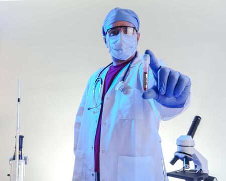 coronavirus epidemic and infectious diseases conceptmale lab technician doing research in the lab with protective suit