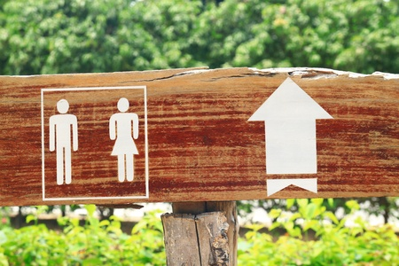 direction of the arrow: toilet sign and  and direction arrow made from wooden