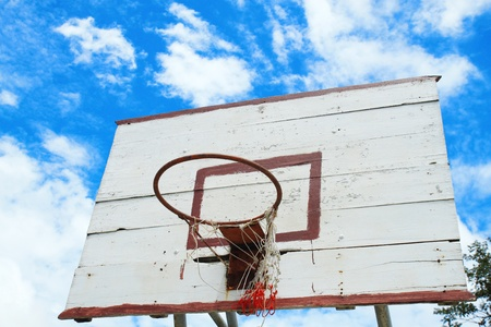 old basketball hoop under blue sky  photo