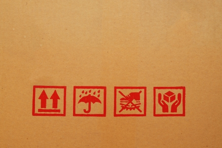 Black fragile symbol on cardboard box photo