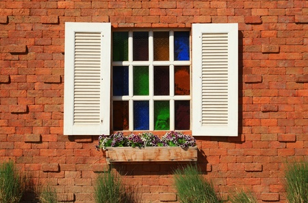 Vintage white window on red brick wall  photo