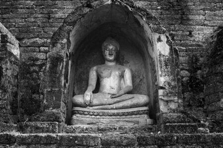 black and white Buddha Statue in Sisatchanalai Historical Park, Sukhothai, Thailand  photo