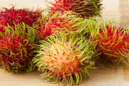 rambutan on wood table photo