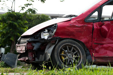 totaled: red car in an accident