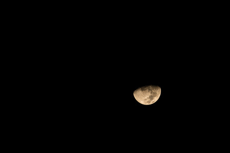 crater highlands: half moon in the dark sky