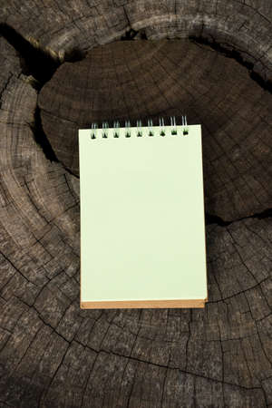 Opened blank notepad on old wooden table photo