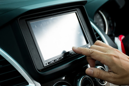 Driver entering an address into the navigation system