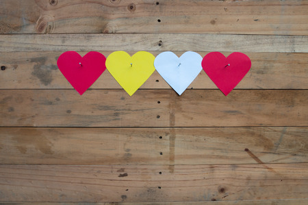 clinch: four paper heart clinch wood with nails Stock Photo