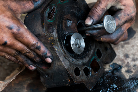 mechanic hands fixing engine power transmission