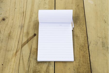 lined: Lined notepad on old wooden background